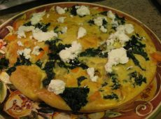 Frittata fresh from the oven with blobs of goat cheese