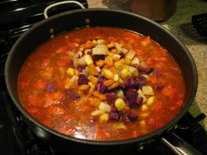 Adding root veggies to rice mixture