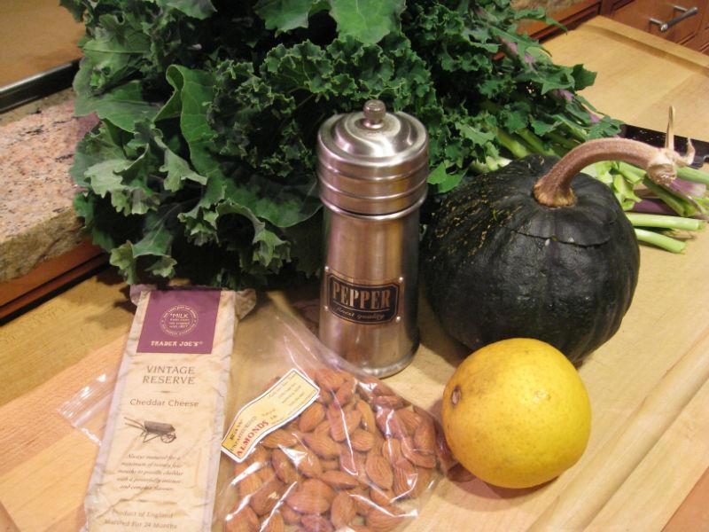 Raw almonds, organic cheddar, home grown kale and lemons with kabocha squash