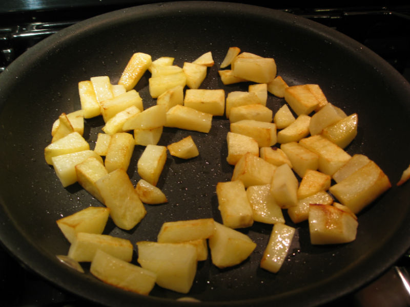 Browning potatoes on the stove.