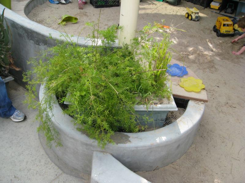 A half-round planter had this awkward plastic planter stuffed inside.