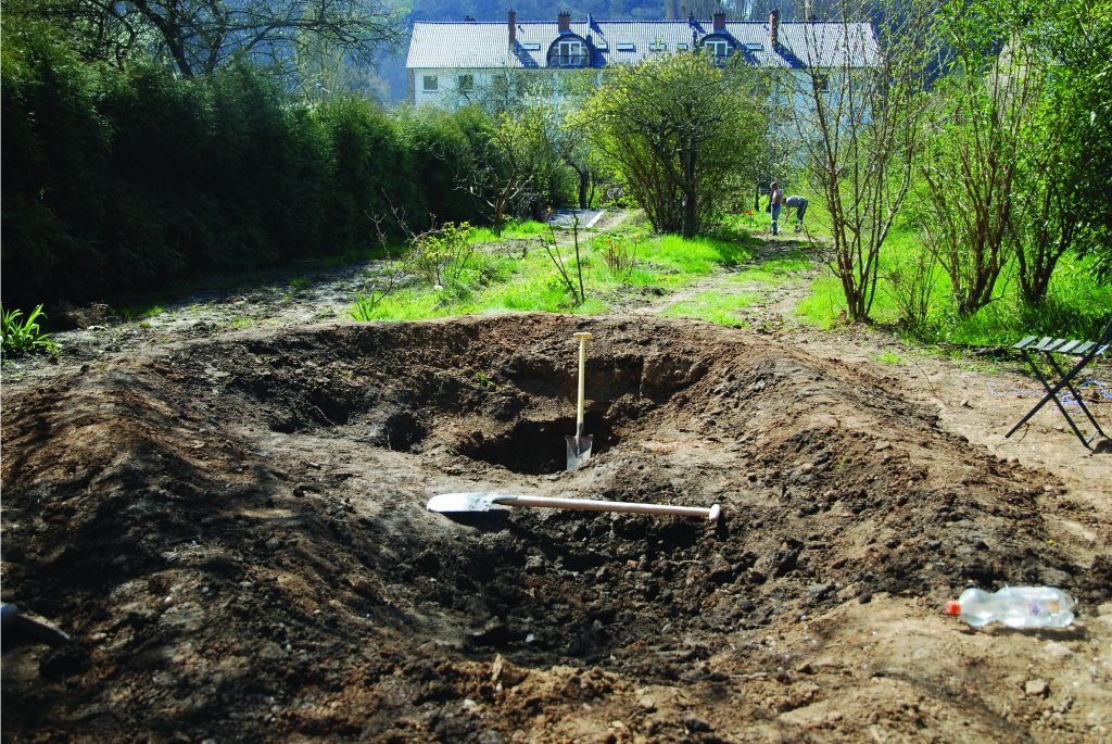 a simple guide to digging a sustainable garden pond
