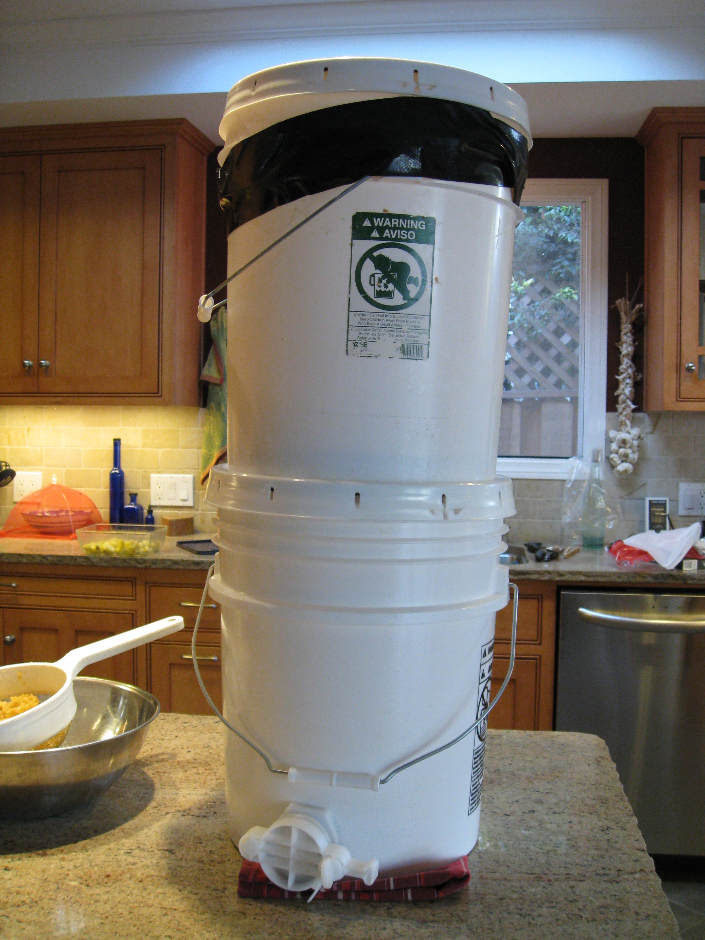 """Strainer bucket sits on top of a bucket with a """"gate"""" that will make bottling easier."""
