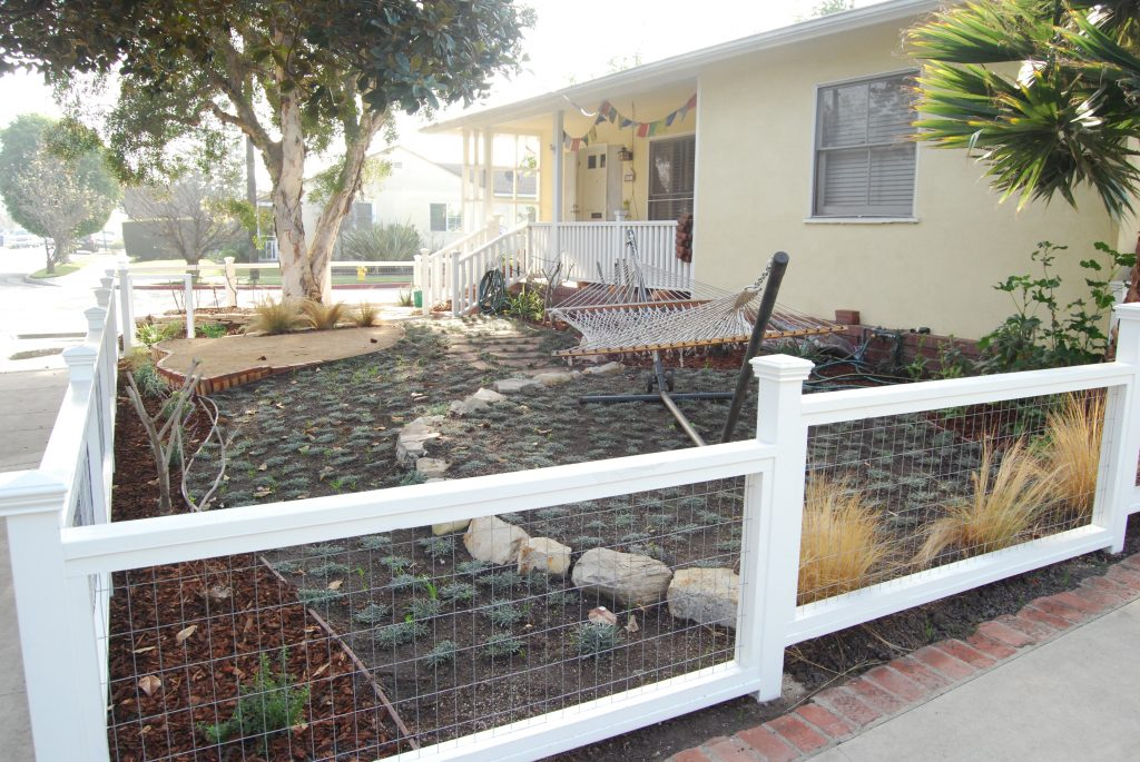 A new fence, dymondia  between flagstone, relocated plants and mulch all bring this garden together.