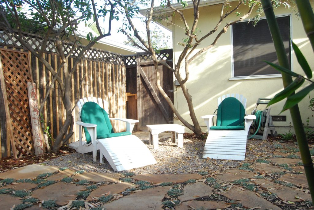 Adirondack chairs needed a home. Now they sit under two citrus trees in their own space. Perfect for reading on a summer day.