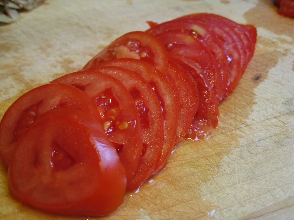 Thinly sliced tomatoes change this dish (for the better, we think).