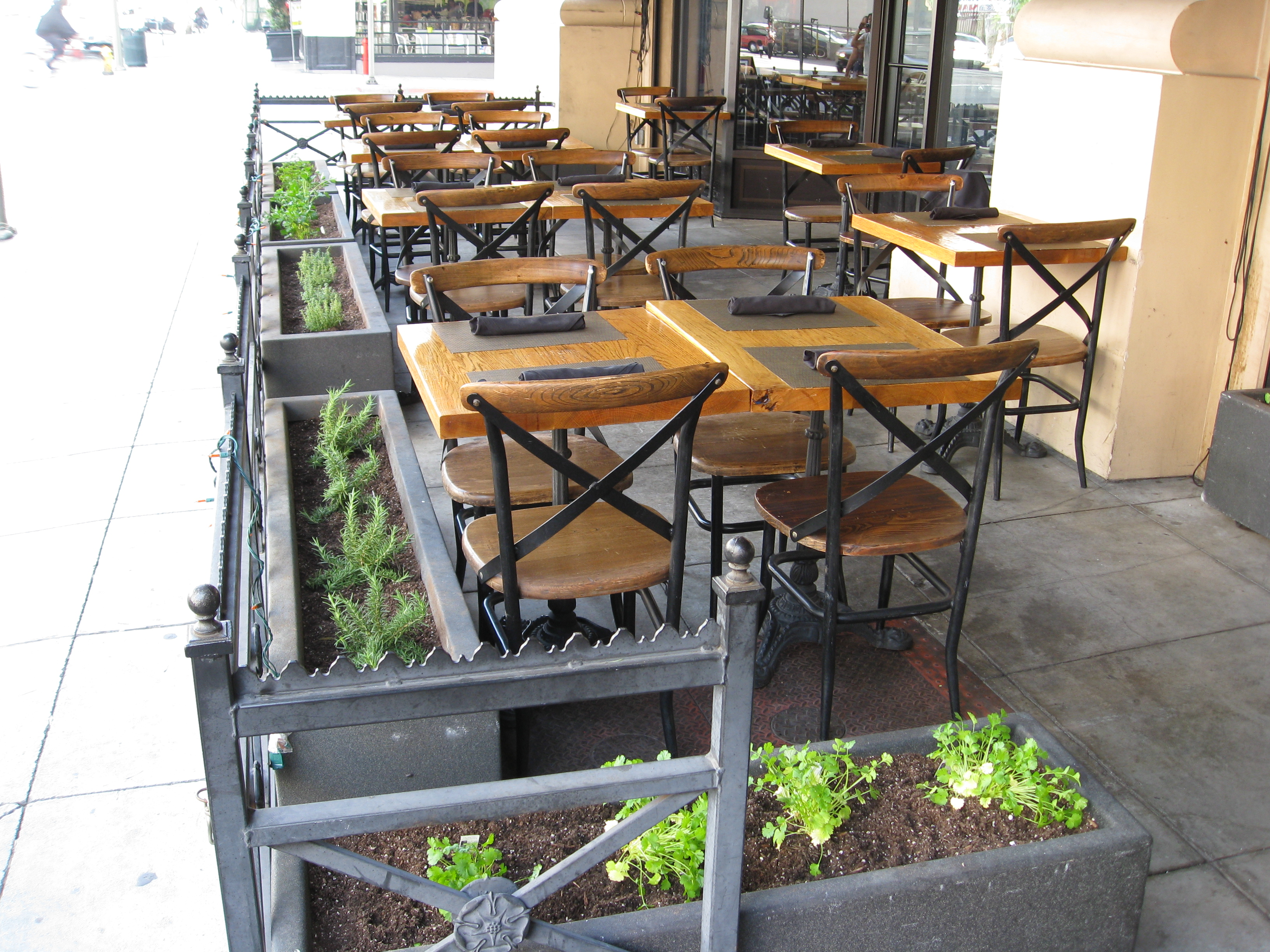 Patio Seating Is Now Surrounded By Herbs For Customers To Enjoy