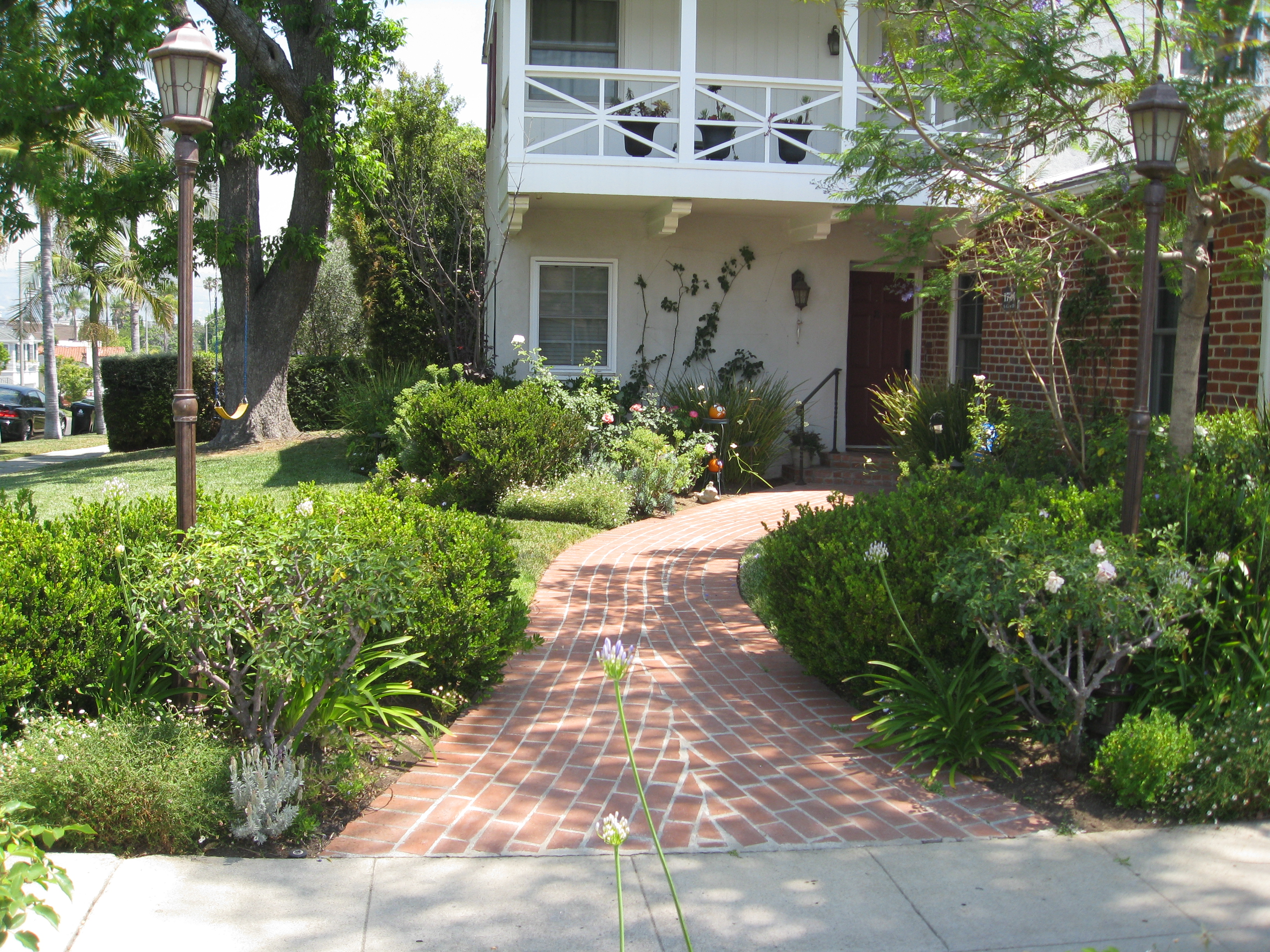 The homeowners didn't like their brick pathway and wanted more native plants in their lives.