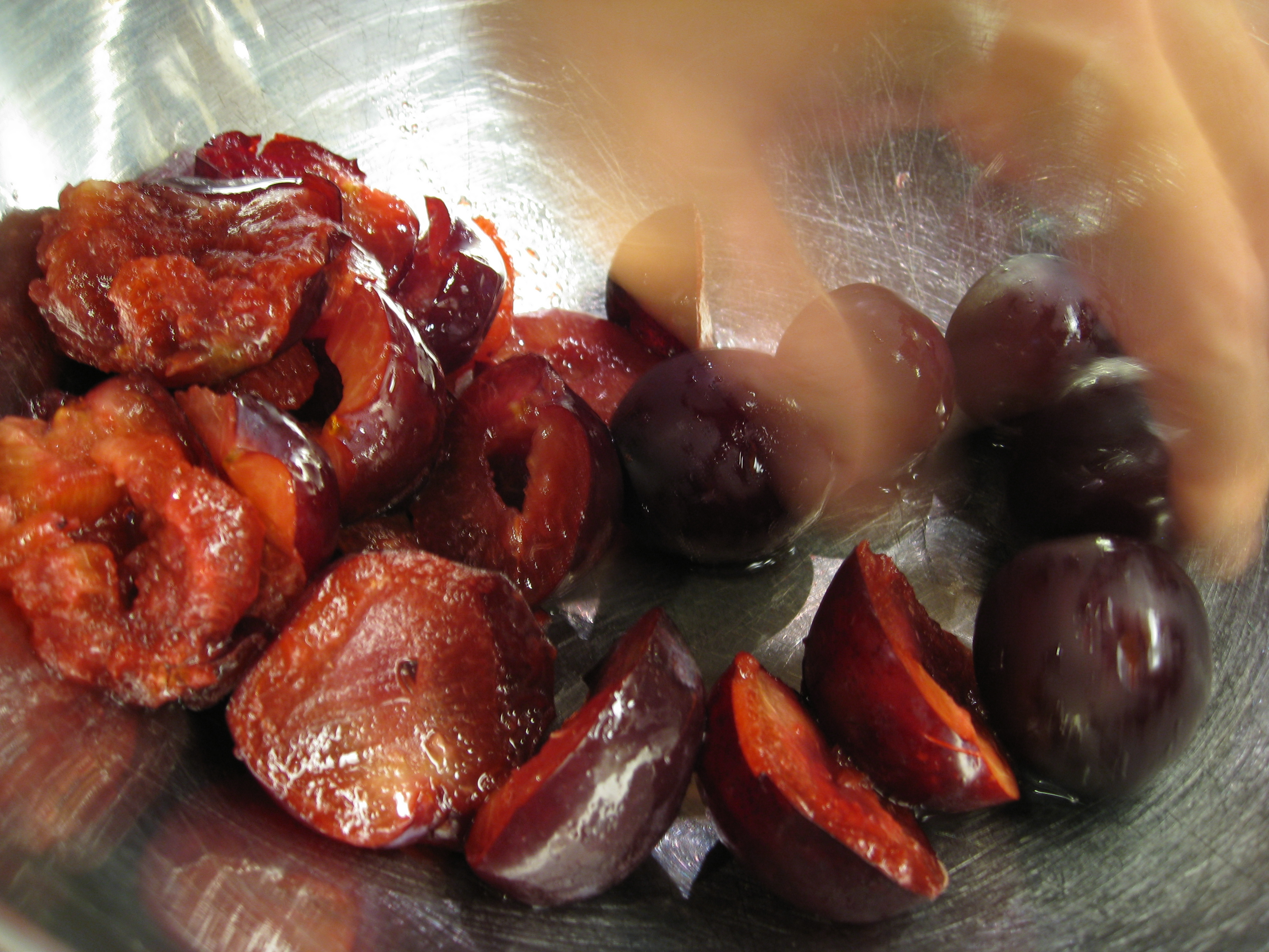 Half and pit plums for this recipe.