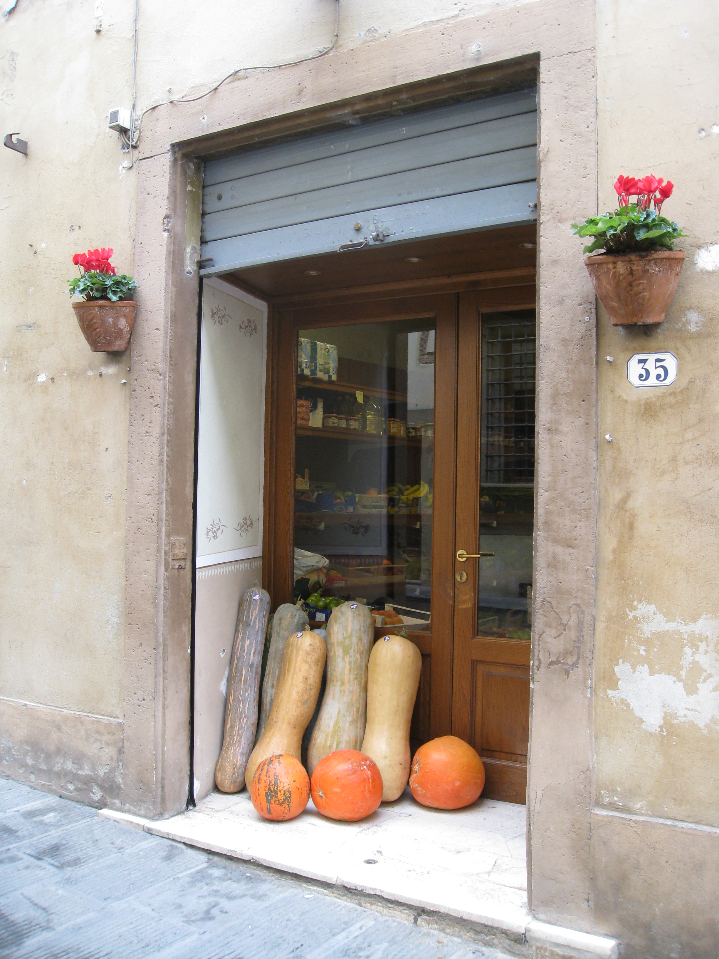 Giant squash decorate the store front for fall in Colle Val D'elsa.