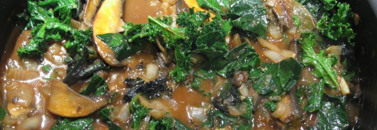 Add tomato paste, kale, the bay leaf, and broth, then simmer for about 10 minutes.