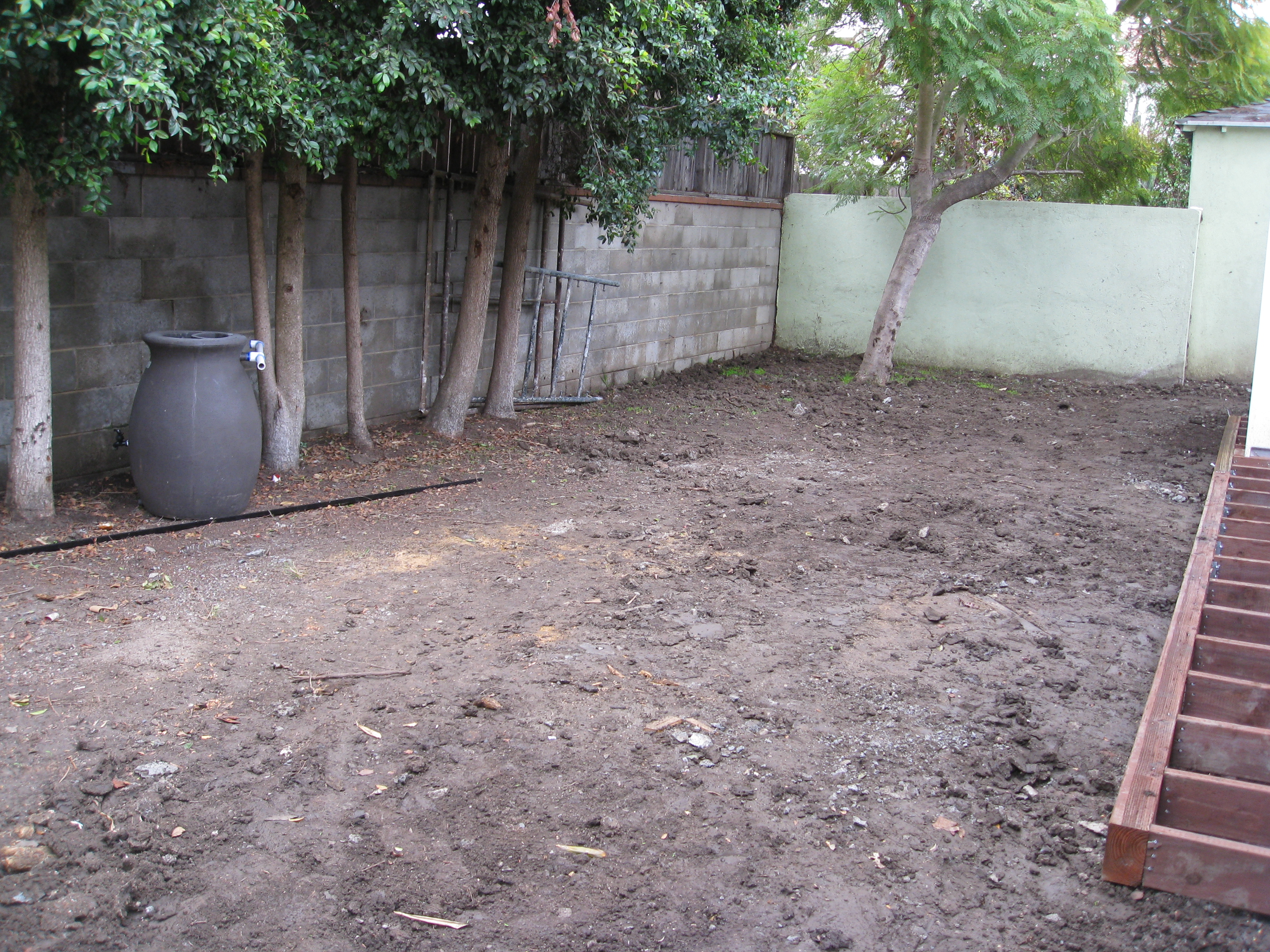 Before: the old lawn was demolished in construction. New decks put in along the house.