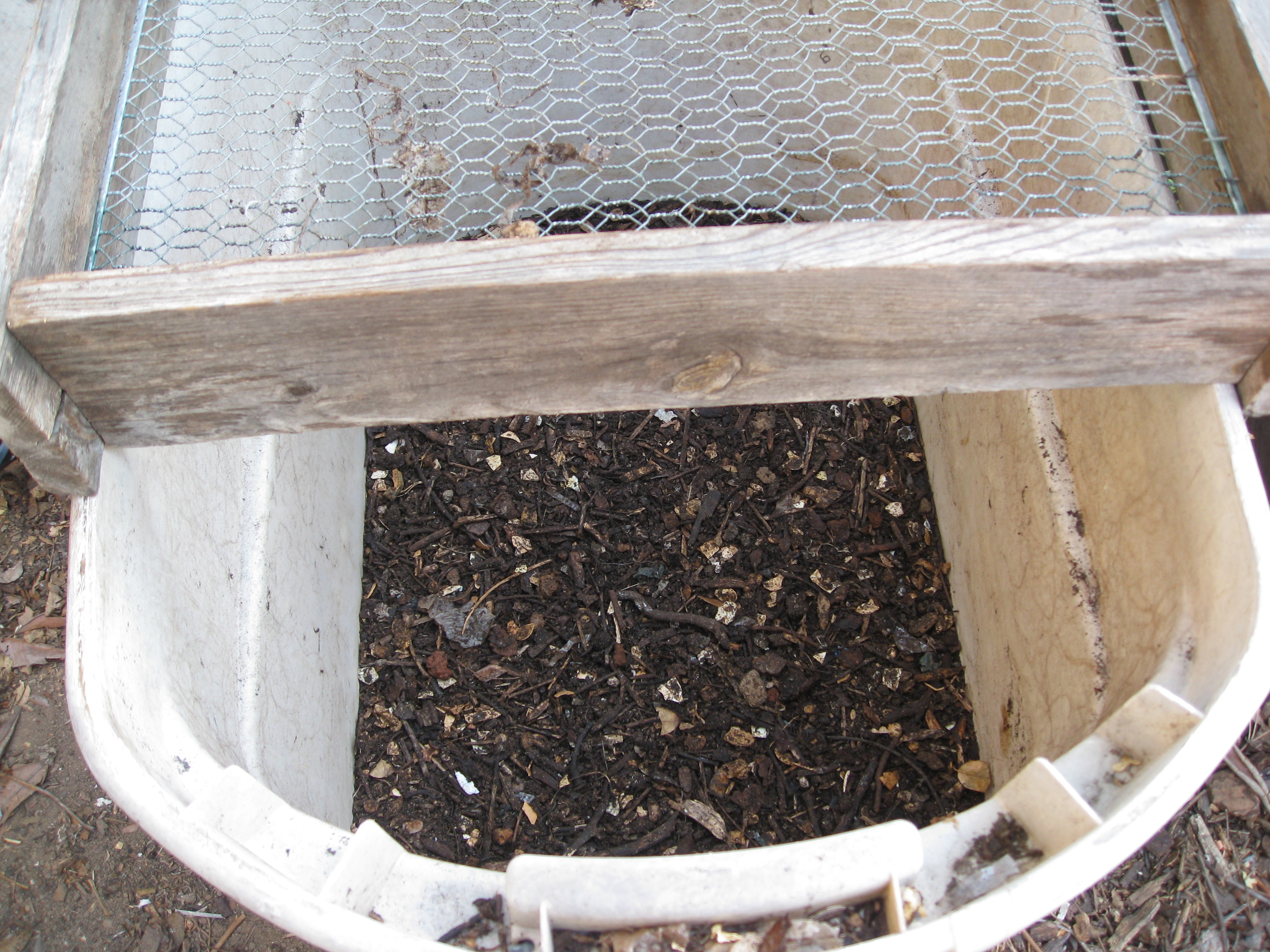 Sift compost before adding it to your garden beds.