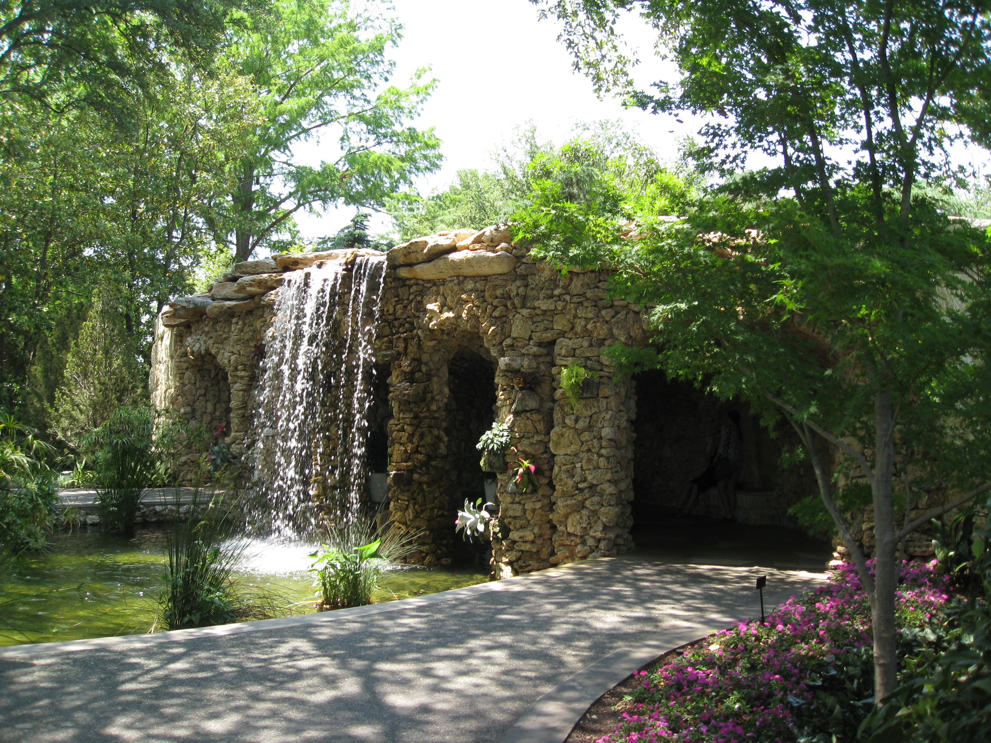 Waterfall and koi pond make a cool rest stop on a hot day.