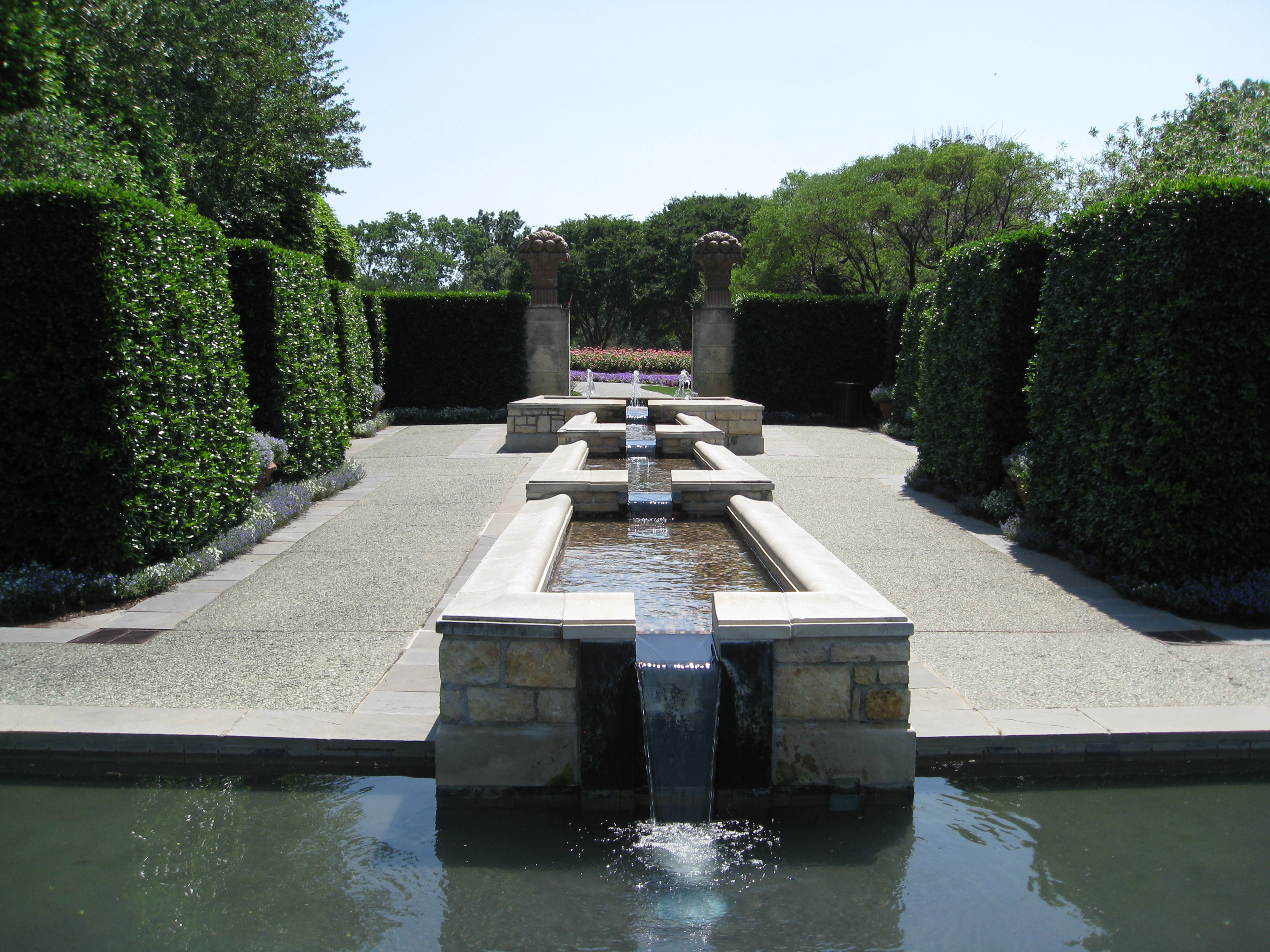 Woman's Garden fountain with formal hedges surrounding.