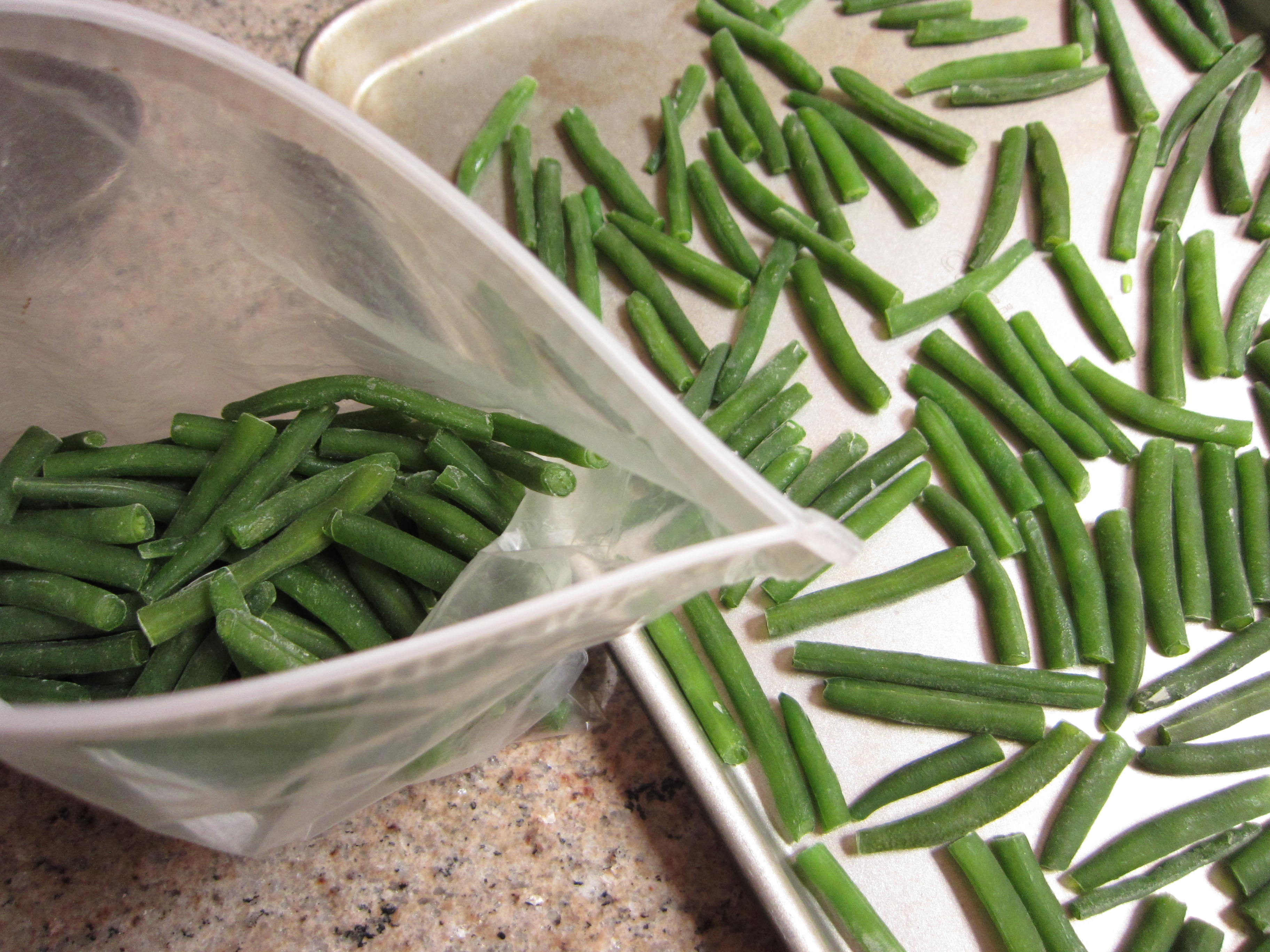 Freeze green beans on a baking sheet first so they won't stick together when bagged for later use.