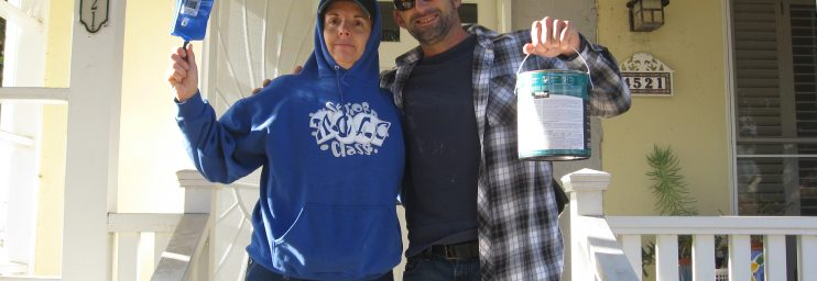 Josh and a DIY client prepping to paint her new fence.