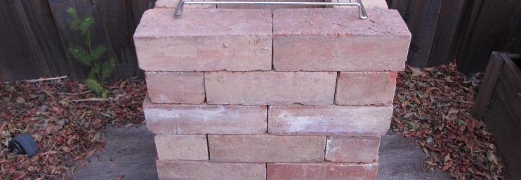 Build up 4 more layers, alternating them like the layer below and place an old oven rack on top.